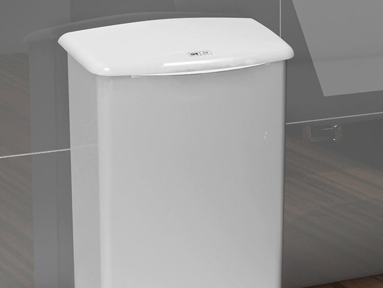 Eine weiße Hygienebox von CWS vor einer grauen Fliesenwand